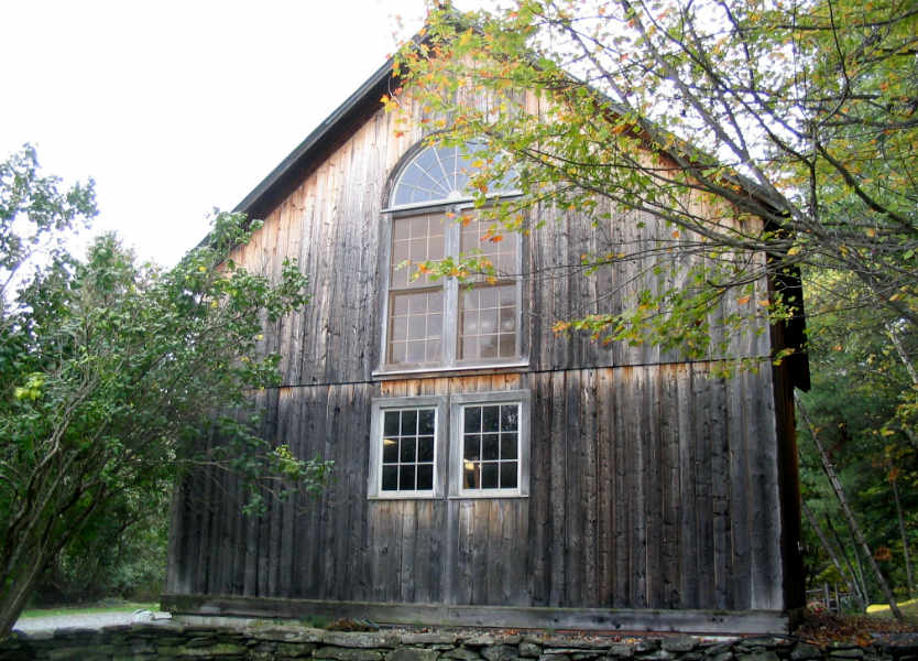 Graying barn converted to house.